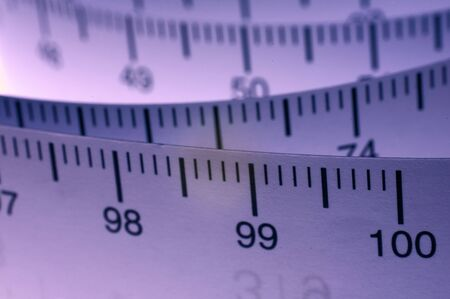 metric: A roll of measuring tape showing the metric centimeter side. Landscape colorised version Stock Photo