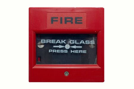 activate: Silightly damaged fire alarm panel. White isolated Stock Photo