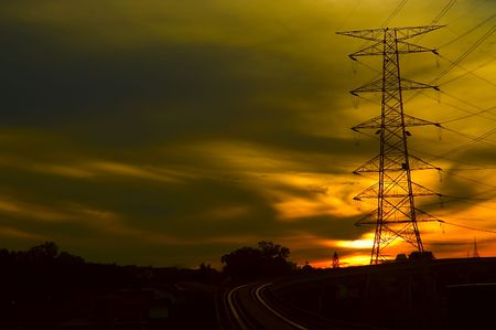 Industrial power grid shot in a red dusky morning.
