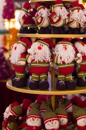 Christmas dolls on a display for sale