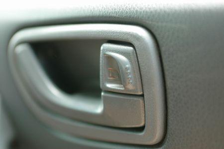 A close up shot of a car door handle photo