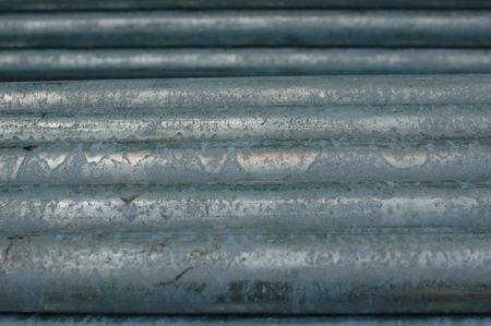 aluminum rod: Stacked metal pipes at a construction site Stock Photo