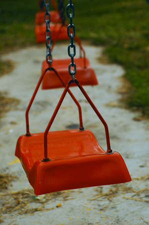 A red swing in the park