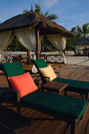 A relaxing beach side gazebo at a luxurious resort