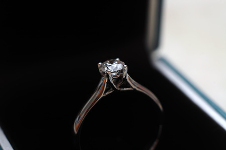 A diamond engagement ring in the ring box Stock Photo