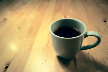 A of a cup of black coffee on wooden table Stock Photo
