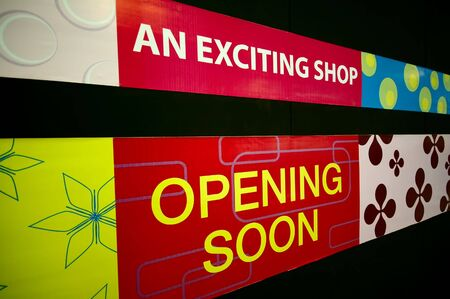 boutiques: An Opening Soon signage at a shopping mall