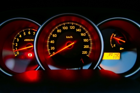 dashboard: A shot of the car dashboard glowing while stationary