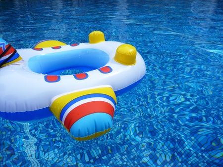A plane shaped children float in a swimming pool