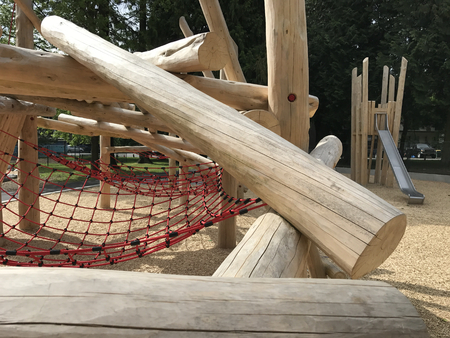 Childrens adventure playground mostly made of clean wooden logs Stock Photo