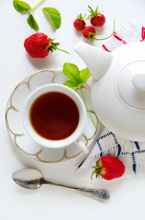 Delicious breakfast of tea, fresh strawberries  isolated  photo