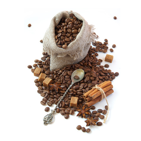 Bag of coffee beans, sugar and cinnamon. Isolated on white background photo