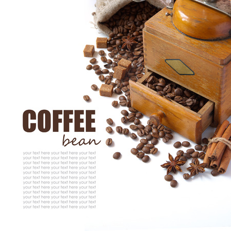 Fresh coffee beans, sweets and coffee grinder. Isolated on white background photo