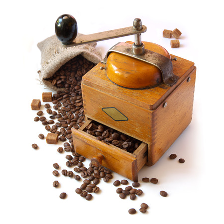 Bag of coffee beans and coffee grinder. Isolated on white background photo