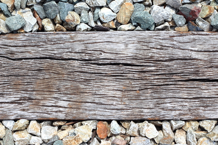 Close Up of wood and rocky gravel stones for Train Tracks, wood background or texture