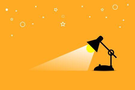 table lamp shining on orange background