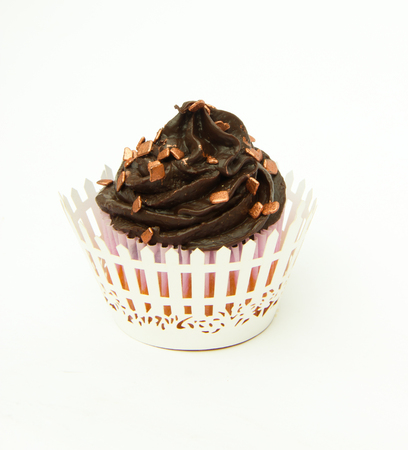 Cupcake with Chocolate top with bronze sprinkles and wrapper photo