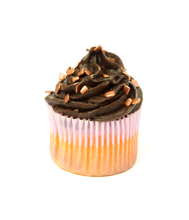 Gluten free cupcake with chocolate top with bronze sprinkles photo