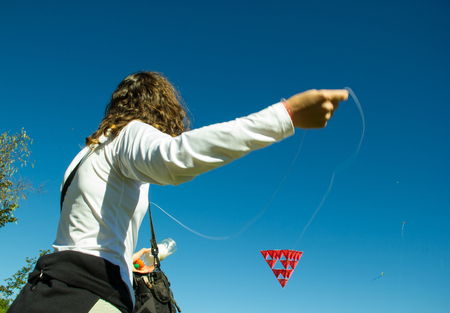 prodigious: Middle Age Woman playing with a Tetrahedral Strange Kite