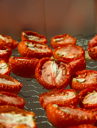 Sun Dried Tomatoes on a simple metal drying tray Stock Photo