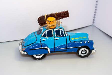 Paper car model - veteran. Souvenir from a holiday in Havna