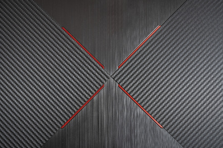 Carbon background on an electric device with red ribbons 版權商用圖片