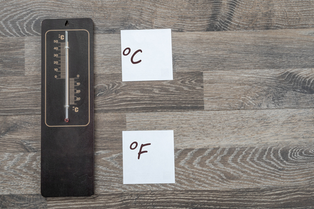 Wooden thermometer for measuring the outside temperature that shows the value in celsius