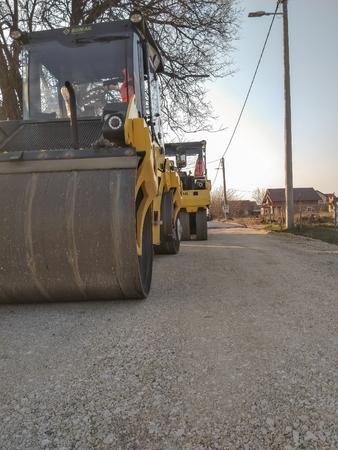 Kladovo, Serbia - March 25, 2019: Asphalting the streets in the city see rollers who are ready to roll asphalt in Kladovo, Serbia