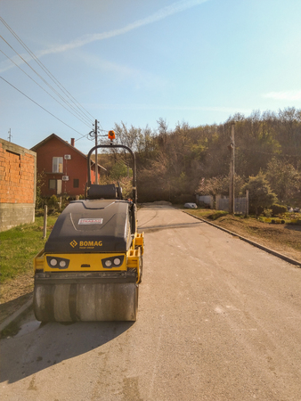 Kladovo, Serbia - March 25, 2019: Asphalting the streets in the city see roller who are ready to roll asphalt in Kladovo, Serbia Editorial