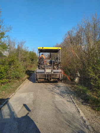 Kladovo, Serbia - April 01, 2019: Asphalting the streets in the city see finisher who are ready to sets asphalt in Kladovo, Serbia