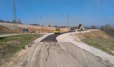 Boljevac, Serbia - April 02, 2019: Asphalt machines set up on the route and workers ready to start ascending the road to Boljevac, Serbia