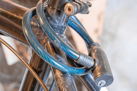 Close up safety locks on bicycles wrapped around the seat tube