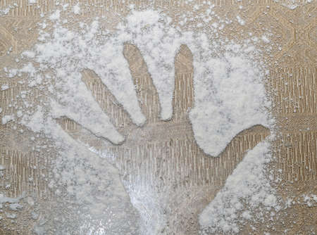 Close up of fists printed on flour sprinkled on the table