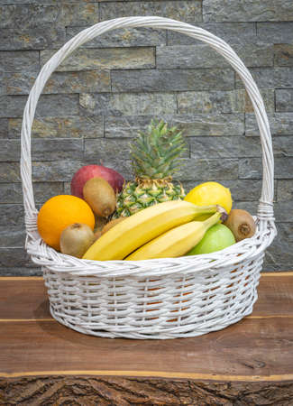 Southern fruit arranged in a basket on the table