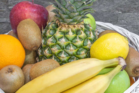 Close up of exotic fruits on a pile in a basket Standard-Bild