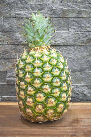 Close up pineapple on the kitchen table Archivio Fotografico