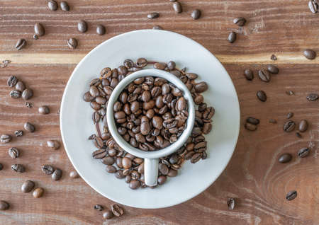 A cup full of coffee beans from above Standard-Bild