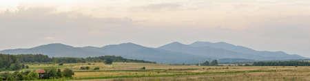 Panorama of Delijovan mountain at cloudy sunset