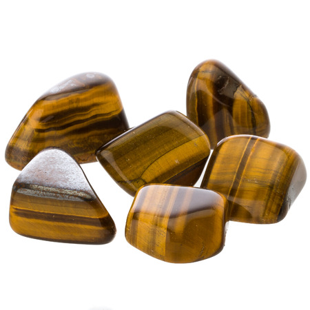 Golden Tiger Eye Tumblestones on white background