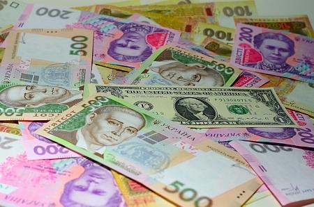 U.S. Dollars, one  dollar bills and Ukrainian Hryvnia closeup