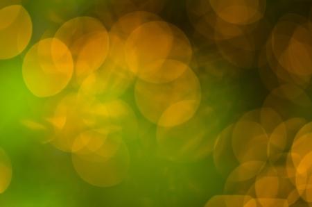 Numerous luminous circles, abstract background  Green, yellow, orange