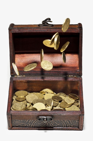 Coins in the air and in a box on a white background  Ukrainian money, hryvnia  Stock Photo