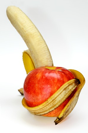 Apple in the arms of a banana on white background  Healthy lifestyle