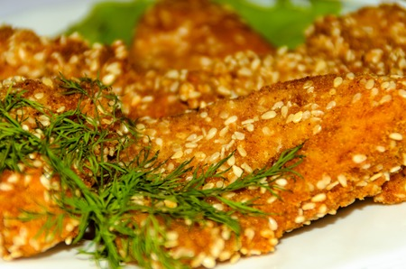 Fried fish in batter with sesame seeds