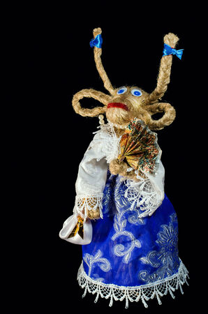 Funny goat clothes on a black background. For New Years greetings. Stock Photo