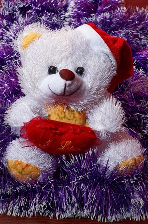 Teddy bear waiting for Santa. Christmas mood. Postcard. Stock Photo