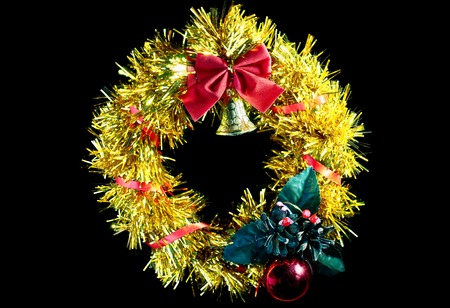 wreathe: Yellow Christmas wreath with a red bow. insulation