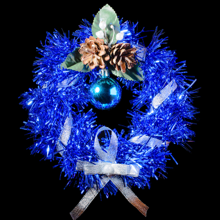 Blue Christmas wreath with ribbon, cones and Christmas toys. Insulation. Stock Photo