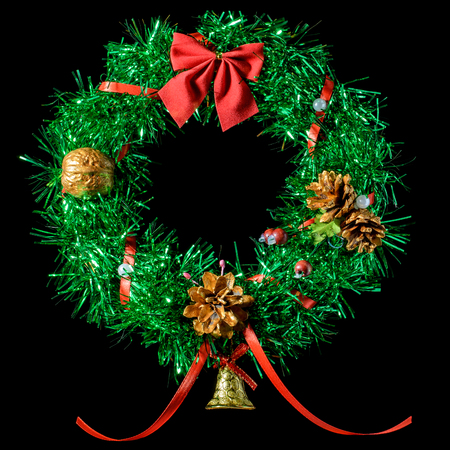 Green Christmas wreath with a red bow. Insulation. Stock Photo