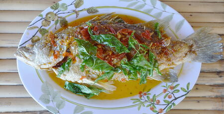 white perch: white perch fish fried with sweet spicy sauce Stock Photo